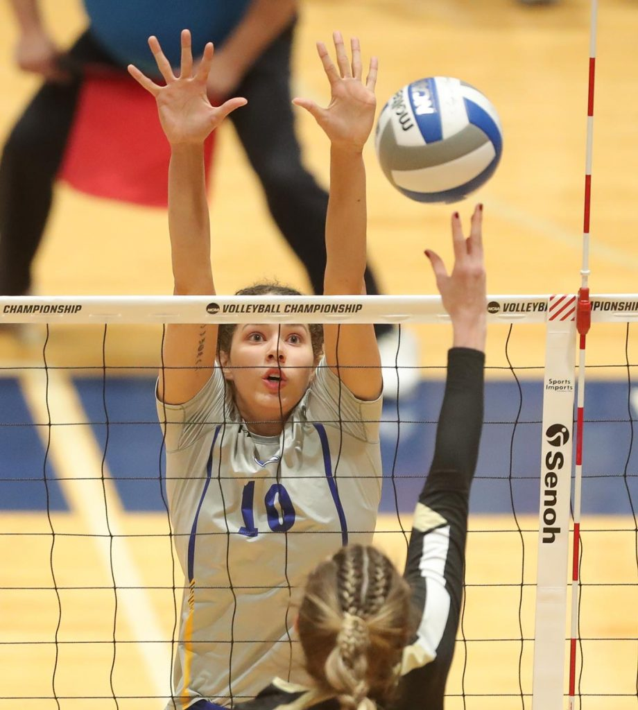 Julianne Jackson goes up for a block in UNK's loss to Harding Thursday in the NCAA Central Regional Volleyball Tournament. Jackson this season finished second on the team with 295 kills and 512 digs, and third with 35 service aces. (Photo by Corbey R. Dorsey, UNK Communications)