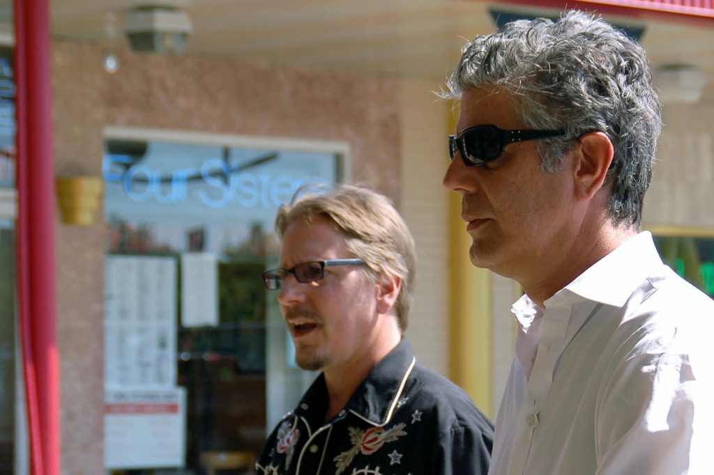 """Washington Post food reporter Tim Carman, left, and host Anthony Bourdain visit the Eden Center in Falls Church, Virginia, while filming an episode of """"No Reservations"""" in 2008. (Photo courtesy of Alan Frank)"""