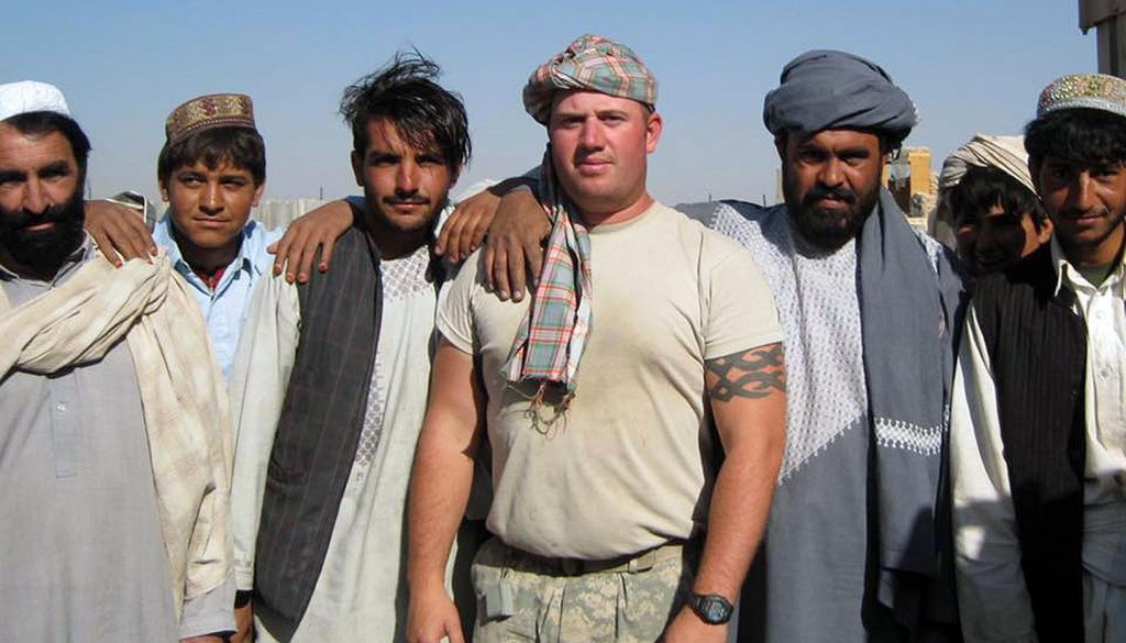 U.S. Army veteran Jason Baker, center, poses for a photo with Afghan workers during a deployment to Afghanistan in 2010-11. (Courtesy photo)