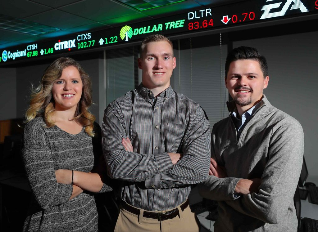 UNK business students use concepts they're learning in the classroom to make real investments through the William Bauhard Student Managed Investment Fund. From left, seniors Madisson Whalen, Adam Starr and Tristan Crook, who recently placed second in a collegiate stock pitch competition in Chicago, say this experience helps prepare them for their future careers. (Photo by Corbey R. Dorsey, UNK Communications)