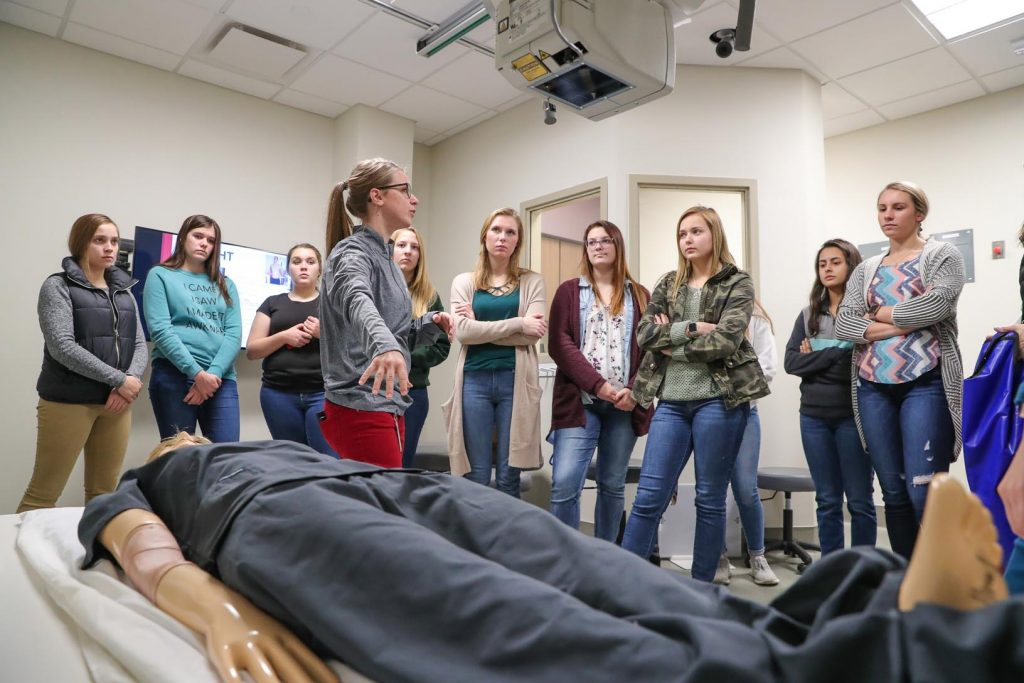 Ellie Miller, an instructor with the University of Nebraska Medical Center College of Allied Health Professions, discusses radiography with high schoolers participating in last week's Health Careers Club session inside the Health Science Education Complex at UNK. (Photo by Corbey R. Dorsey, UNK Communications)
