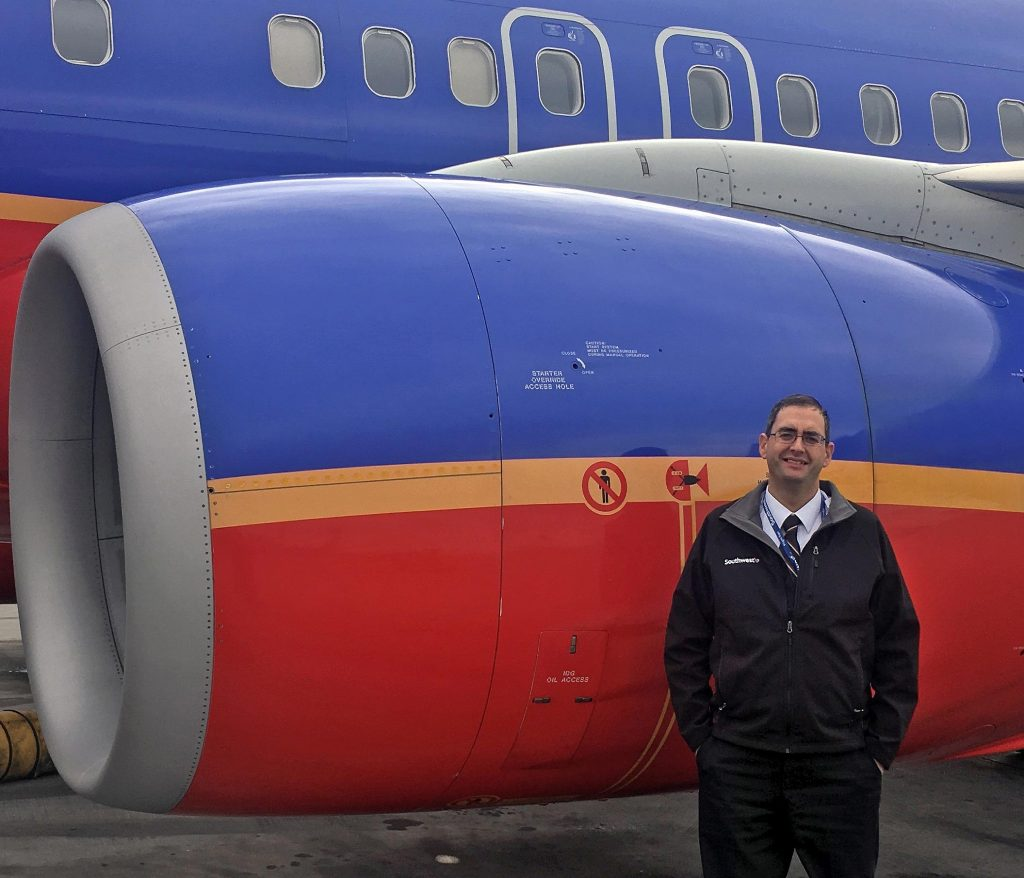 "UNK graduate Jason Hughes worked as a corporate pilot and with Minneapolis-based Compass Airlines before landing a job with Southwest Airlines about three months ago. ""It's really cool to get out and see the country – and get paid to do it,"" the Burwell native said. (Courtesy photo)"