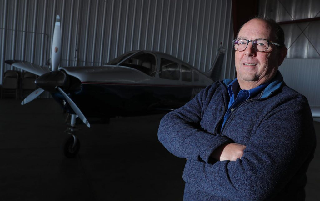 "In addition to directing UNK's aviation program, Terry Gibbs is a designated pilot examiner through the Federal Aviation Administration. ""There are fewer than 600 of us worldwide who can actually issue a pilot's license,"" Gibbs said, ""and one of them is sitting here in Kearney, Nebraska."" (Photo by Corbey R. Dorsey, UNK Communications)"