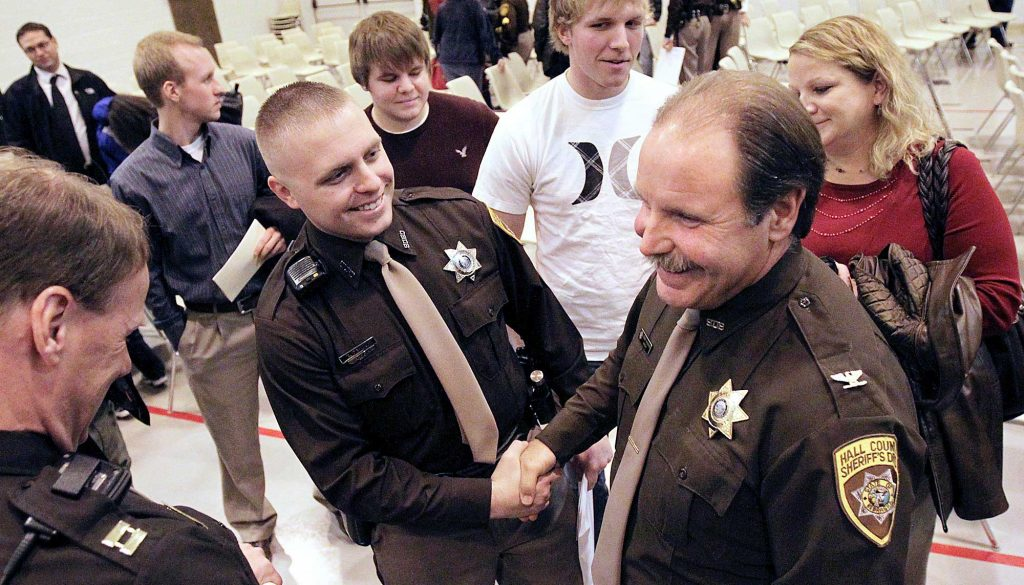 Former Hall County Sheriff Jerry Watson, right, served as an instructor at the Nebraska Law Enforcement Training Center and helped launch the Central Nebraska Drug Court during his 30-year law enforcement career. Now he's a student at UNK finishing a degree he started four decades ago. (Photo courtesy of Barrett Stinson/Grand Island Independent)